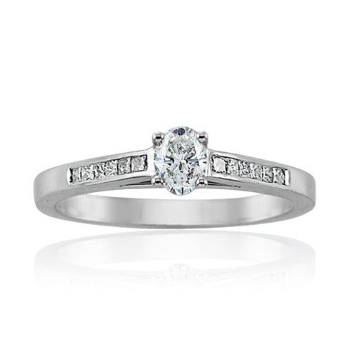 Steffans Oval Shaped Diamond Platinum Solitaire Engagement Ring with Channel Set Princess Cut Diamond Shoulders (0.33ct)